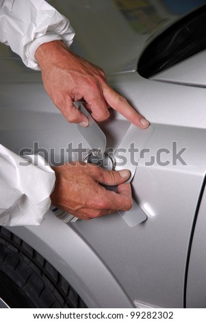 man tries to find the right car painting color