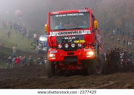 man truck driving up hill