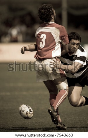 Man trying to bring down opponent at the International Rugby 7s 2007 game