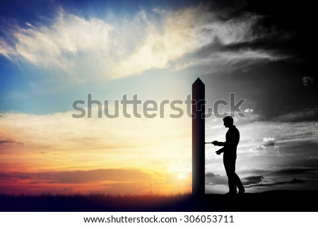 Man trying to open door to a new better world. Conceptual change, two worlds, hell and paradise.  Stock photo ©