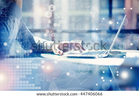 Man Typing Keyboard Laptop Hand.Project Manager Researching Process.Business Team Working Startup modern Office.Global Strategy Virtual Icon.Innovation Graphs Interfaces.Analyze market stock.Blurred #447406066