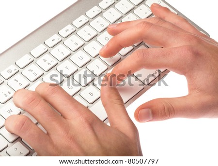 man typing on a keyboard on white background - stock photo
