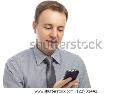 Man typing text message on mobile phone and smiling.