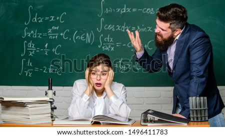 Man unhappy communicating. Conflict situation. School conflict. Demanding lecturer. School principal talking about punishment. Teacher strict serious bearded man having conflict with student girl. #1496411783