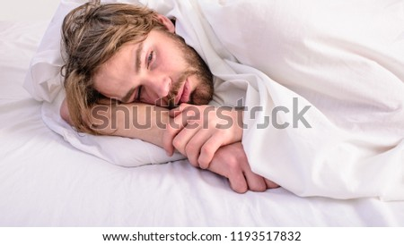 Man unshaven handsome relaxing bed. Man sleepy drowsy unshaven bearded face covered with blanket having rest. Guy lay under white bedclothes. Fresh bedclothes concept. Let your body feel comfortable. #1193517832