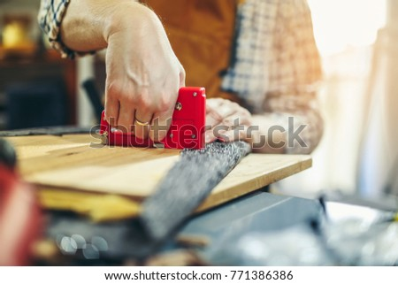 Man upholstering chair in his workshop, close up - Shutterstock ID 771386386