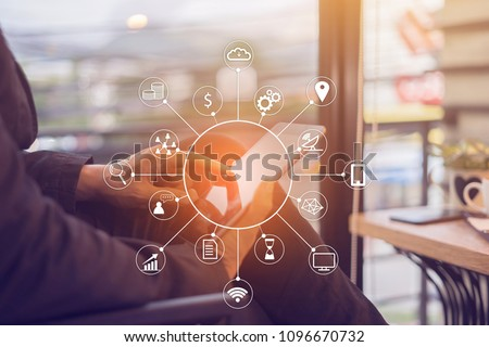 Man use Internets marketing e-commerce,online banking payment,VOIP voice over internet technology on mobile smart phone device app digital icon,computer communication security service on tablets pc