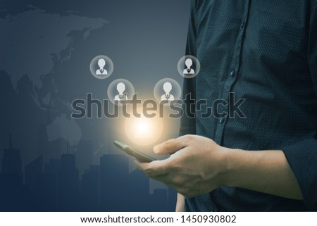 Man use smart phone for select employee icon human resource system. #1450930802
