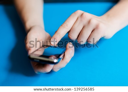 man uses a mobile phone - stock photo