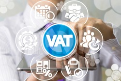 Man uses tablet pc and virtual screen sees the acronym: VAT. VAT Value Added Tax Business Finance concept.