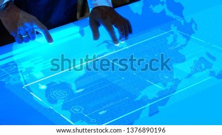 Man using a flat blue touchscreen computer #1376890196