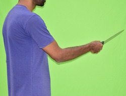 man using a knife to stab someone on green screen