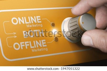 Man using a rotary knob to switch strategies and to select both online and offline marketing channels. Composite image between a hand photography and a 3D background. Stock foto ©