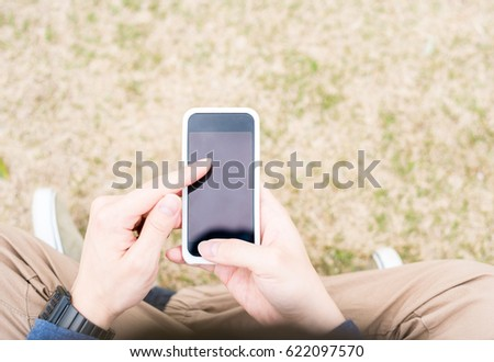 Man using a smartphone #622097570