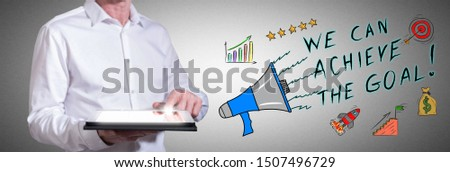 Man using a tablet with goal achievement concept