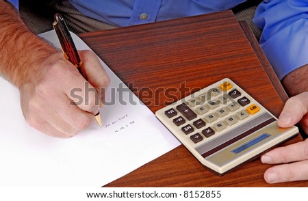 Man Using Calculator Working on Budget