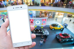 man using cell phones in motor show in Department store, background.