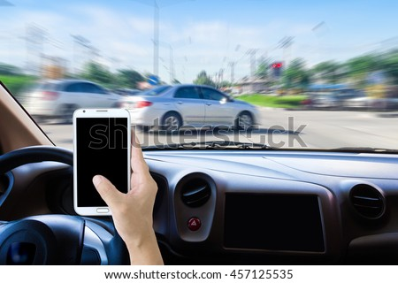Man using cell phones while driving,  motion image of accident will happen as background. Foto stock ©