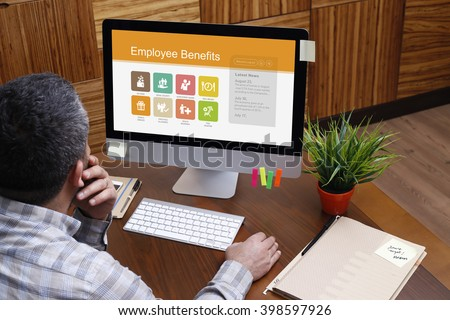 Man using computer with Employee Benefits concept on screen