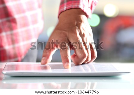 Man using digital tablet, Close-up