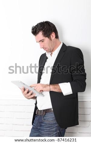 Man using electronic tablet
