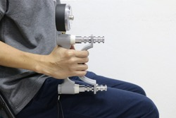 man using grip strength dynamometer for testing hand grip strength. Testing hand grip strength. Hand grip strength evaluation for health indicator