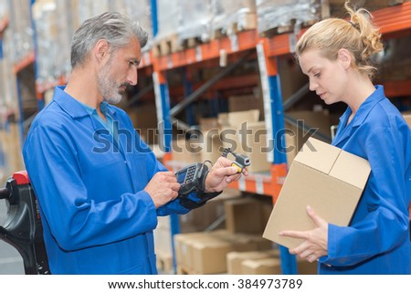 Man using handsfree computer and scanner on parcel