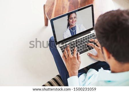 Man using his laptop to get medical consultation online from Indian doctor