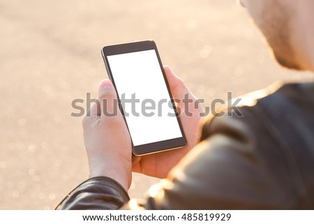 Man using his Mobile Phone outdoor, close up stock photo