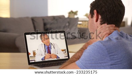 Man using laptop to talk to doctor