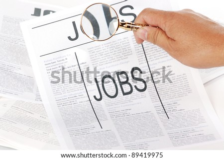 man using magnify looking for jobs