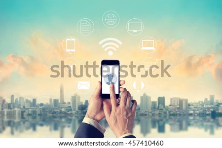Man using mobile payments, holding circle global and icon customer network connection, Omni Channel or multi Channel