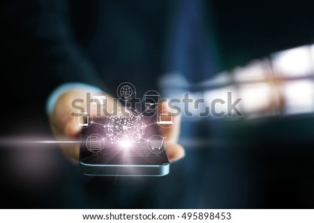 Man using mobile payments, holding circle global and icon customer network connection, Omni Channel  #495898453