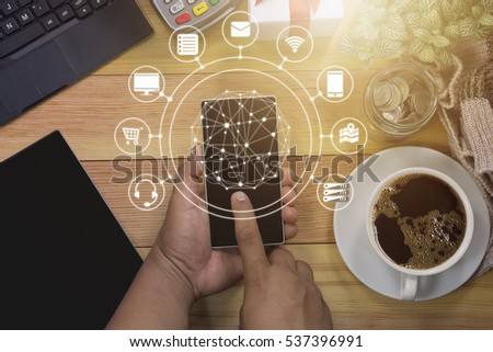 Man using mobile payments online shopping and icon customer network connection on screen / technology and Business concept