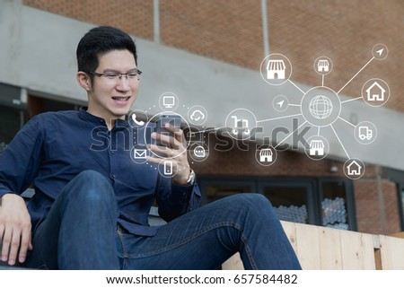 Man using mobile payments online shopping and icon customer network connection on screen, m-banking and connecting with omni channel vendor. Internet of thing, Multi-channel or Omni channel concept.