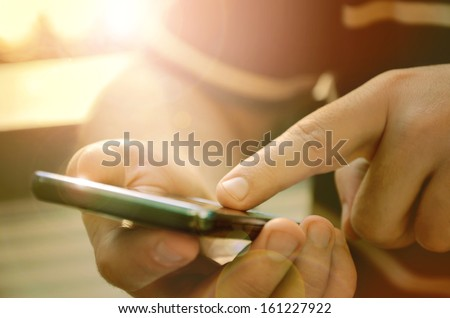 Man using mobile smart phone outdoor