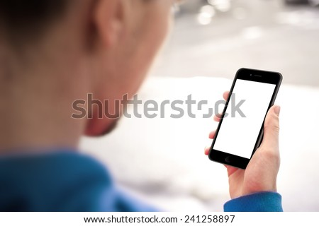 Man using mobile smartphone. Shot with third-person view, blank screen
