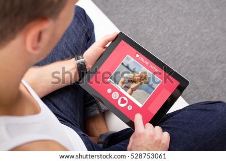 Man using online dating app on tablet
