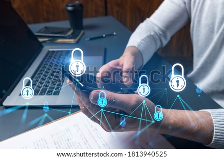 Man using phone. Hands typing smartphone. Double exposure with lock icon hologram. Close up. Datum cyber safety concept. Protection from hacker attack.