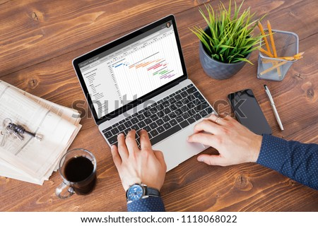 Man using project management software at work