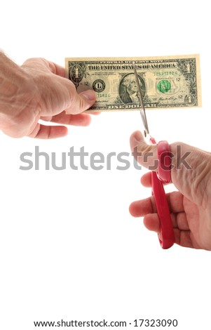 Man using scissors to cut US $1 bill