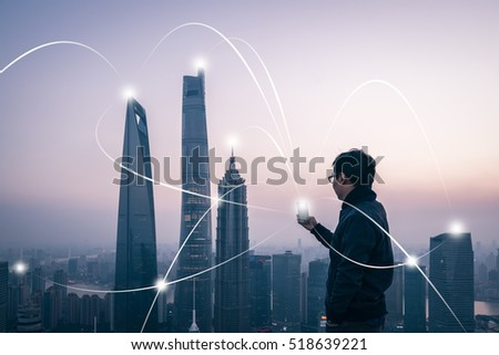man using smart phone with city network connection technology