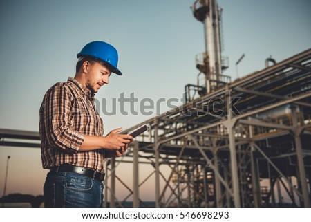 Man using tablet at natural gas factory