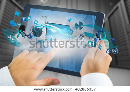 Man using tablet pc against a large room where are standing the servers