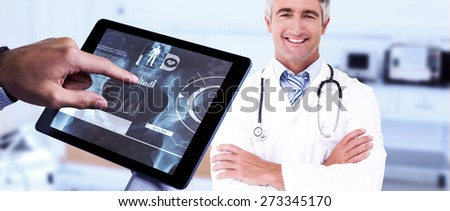 Man using tablet pc against empty bed in the hospital room