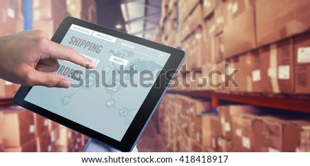 Man using tablet pc against shelves with boxes in warehouse - Shutterstock ID 418418917