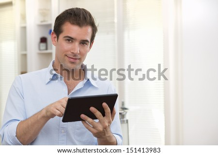 Man using tablet pc indoor