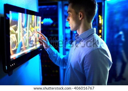 Man using touchscreen in university or museum