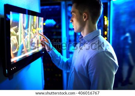 man using touchscreen in...