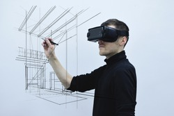 Man using virtual reality glasses. 2016 edition. Drawing architectural sketch.